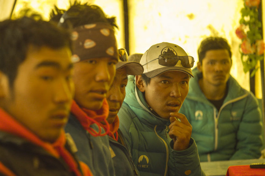 """A still from the movie """"Sherpa"""" shows a group of Sherpa attending meeting after the avalanche. Photo courtesy the Discovery Channel.)"""