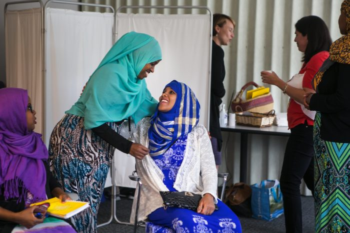 Nurse Geni Sheikh gives a hug to Roda Mahamoud, expecting her first baby, during the Somali CenteringPregnancy program at the Neighborcare Health clinic in Columbia City. (Photo by Bettina Hansen for the Seattle Times)