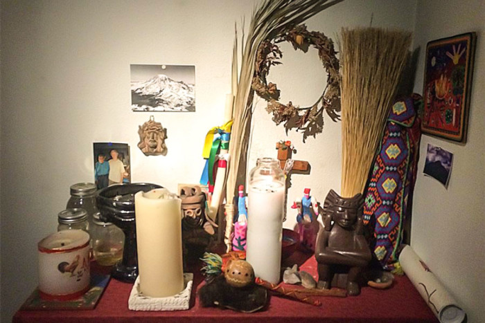 A picture of Peter Brown and his Huichol teacher is pinned to the wall of his practice next to a collection of items gathered during his pilgrimages to Mexico. (Photo by Cristina Acuña)