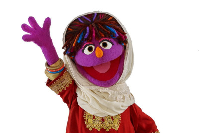 The newest member of Sesame Street's international cast is Zari, an Afghan Muppet who wears traditional clothing from the country's different ethnic groups. (Photo from REUTERS/ John E. Barrett)