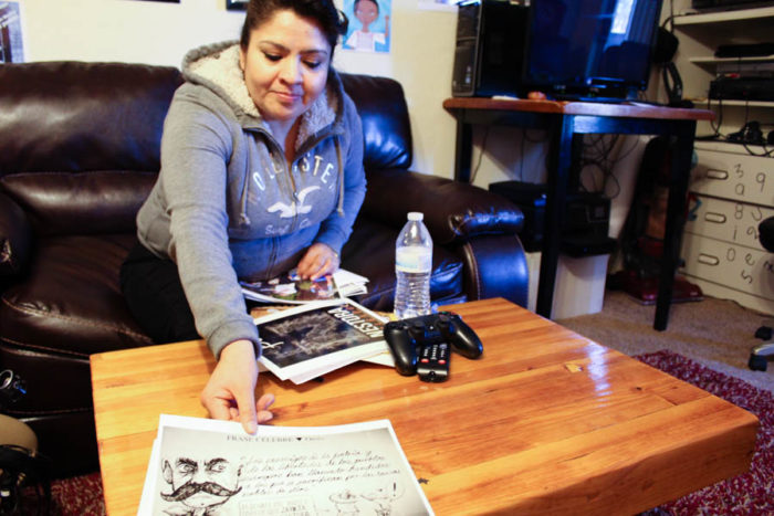 Nestora Salgado in her Renton home showing a political cartoon featuring her court case. Her incarceration became a cause celebre in Mexico. (Photo by Venice Buhain.)