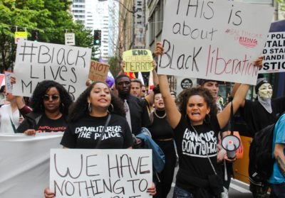Black Lives Matter protesters side by side with anarchists during the 2015 May Day protests. (Photo from Flickr by scottlum)