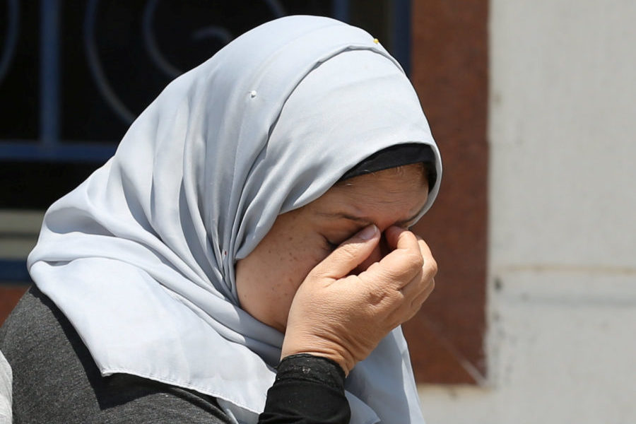 An unidentified woman reacts as she waits outside the Egyptair in-flight service building, where relatives and friends of passengers who were flying in an EgyptAir plane that vanished from radar en route from Paris to Cairo are being held, at Cairo International Airport, Egypt May 19, 2016. (Photo by Mohamed Abd El Ghany for Reuters.)