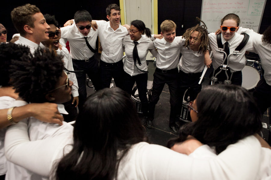 The Garfield High School drumline comes together for a group huddle before performing at the 8th Annual Bulldog Drumline Expo (BDX) on Saturday, May 28, 2016. The Garfield High School BDX is the largest drumline competition in Washington State. (Photo by Jovelle Tamayo)
