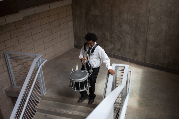 Senior Upendo Moore makes his way to practice before performing at the 8th Annual Bulldog Drumline Expo (BDX) on Saturday, May 28, 2016 with the Garfield High School drumline. The Garfield High School BDX is the largest drumline competition in Washington State. (Photo by Jovelle Tamayo)