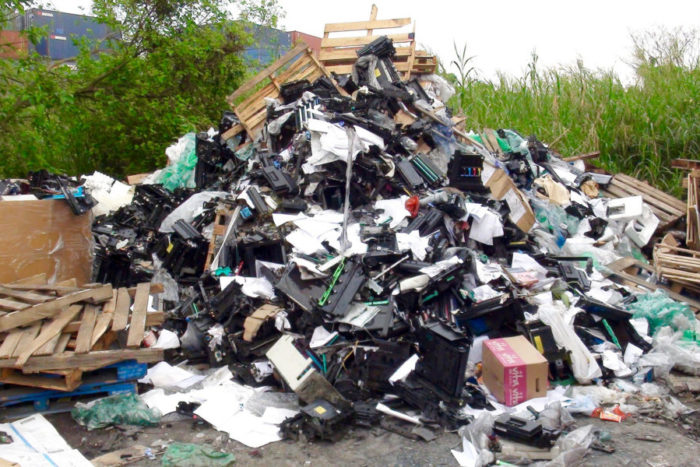 Pile of printer scrap outside on ground near New Territories junkyard in New Territories Hong Kong in March. (Photo by Basel Action Network via Flickr.)