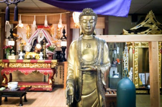 A statue of the Buddha from Seattle's Choeizan Enkyoji Nichiren Buddhist temple bearing the Buddhist swastika. (Photo by Tim Gruver)