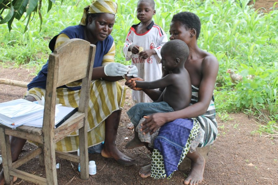 A community health worker with a mom and her child in Togo. (Photo courtesy 30/30 Project.)