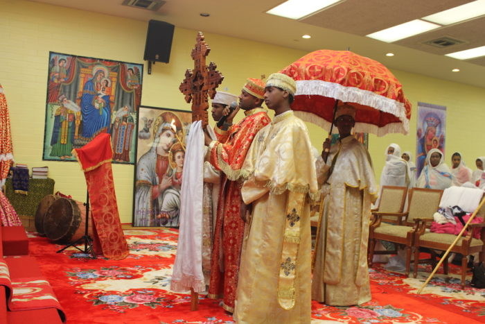 Archdeacon of the Mass team singing the Psalm of the day at the Ethiopian Orthodox Tewahedo Church's new space in Skyway. (Photo by Goorish Wibneh.)