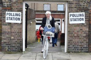 A woman cycles out of a polling station for the Referendum on the European Union in Chelsea, London, Britain, June 23, 2016.      (Photo by Toby Melville for Reuters.)