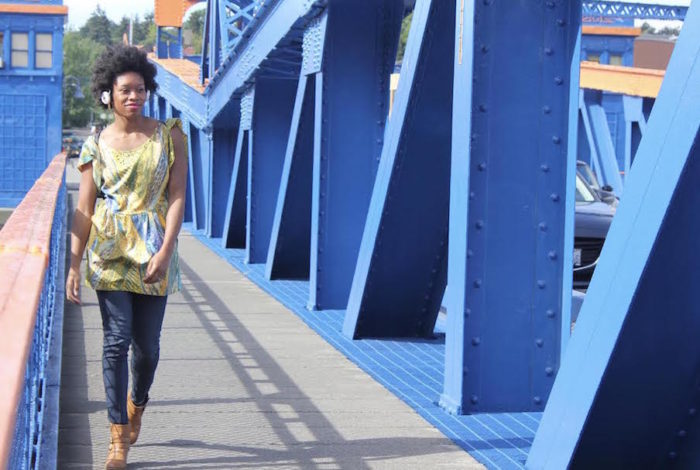 Seattle's Angela Tucker walks across the Fremont Bridge on her daily walk back home from Seattle Pacific University. (Photo by Damme Getachew)