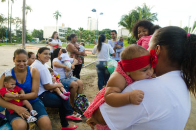 """Members of the """"Union of Mothers of Angels"""" group, whose babies all have microencephaly, gather at a park in Pernambuco to prepare for a street protest. (Photo by Katherine Jinyi Li)"""