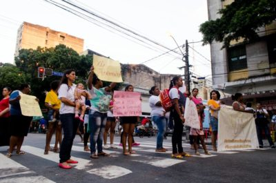 """UMA mothers block traffic in Recife chanting """"Respect!"""" and holding signs that read """"Boo, prejudice."""" (Photo by Katherine Jinyi Li)"""