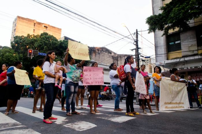 "UMA mothers block traffic in Recife chanting ""Respect!"" and holding signs that read ""Boo, prejudice."" (Photo by Katherine Jinyi Li)"