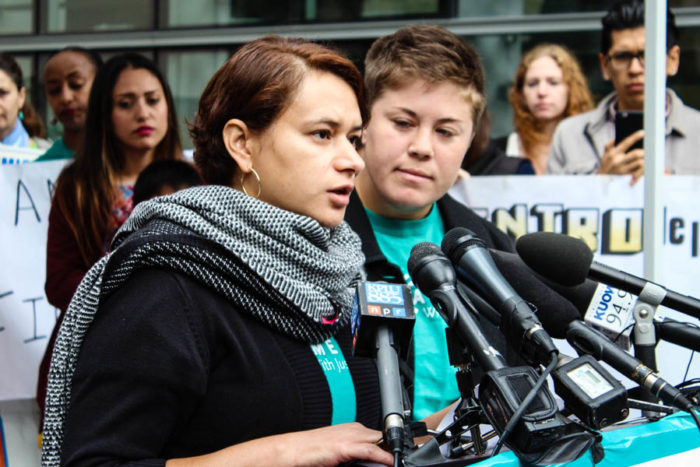 Ela Tinoco speaks at a press conference in Seattle. Tinoco would have qualified for the DAPA program. (Photo by Venice Buhain.)