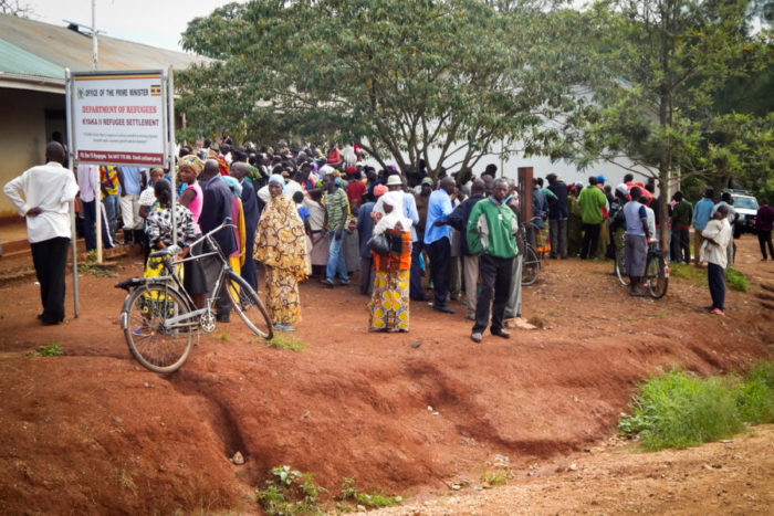 Refugees from Burundi stand in line for registration at Kyaka II, a refugee settlement. An influx of refugees has increased pressure on the environment in the surrounding area, officials say. (Photo by Edna Namara, GPJ Uganda)