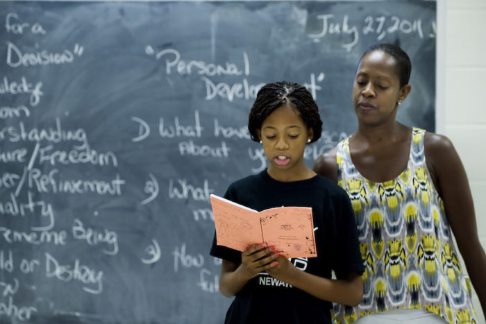 A 2011 AileyCamper with Thomas in a personal development class in Newark, New Jersey. (Photo by Joe Epstein)