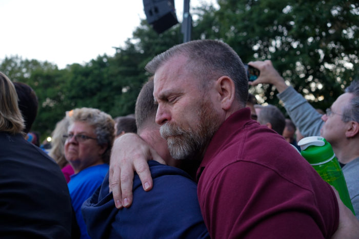 Mourners hug at a gathering at Cal Anderson Park on Sunday to commemorate the victims of a mass shooting at a nightclub in Orlando. (Photo by Chloe Collyer.)