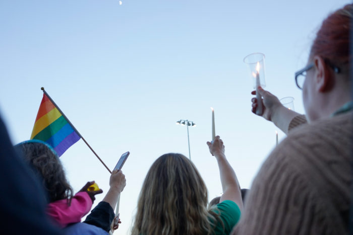 About 1,000 people gathered at Cal Anderson Park in Seattle Sunday night to honor the 49 victims of a mass shooting at a nightclub in Orlando. (Photo by Chloe Collyer.)