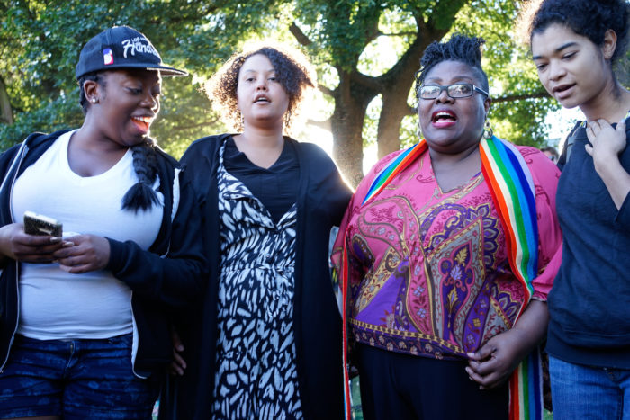 Mourners gathered at Cal Anderson Park in Seattle to commemorate the victims of the shooting at Pulse Orlando nightclub in Florida. (Photo by Chloe Collyer.)