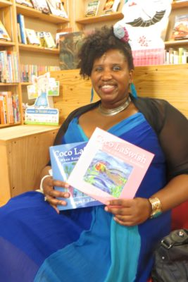 "Reagan Jackson poses with her ""Coco LaSwish"" childrens' books. Jackson will perform a reading of her books at the new Third Place Books in Seward Park on July 9. (Photo by Samantha Pak)"