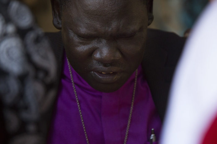 Bishop Kuol leads a prayer with homeless South Sudanese refugees living in the Jungle. (Photo by Sy Bean / The Seattle Times)