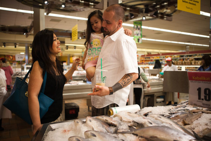 The Hermens family shopping at the Seafood City Supermarket inside Southcenter Mall. The mall draws thousands of people from Seattle and surrounding areas to Tukwila everyday. (Photo by Ian Terry)