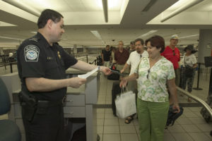 A U.S. Customs and Border Protection officer checks a passenger's documentation after arriving to the U.S. (Photo by the U.S. Customs and Border Protection.)