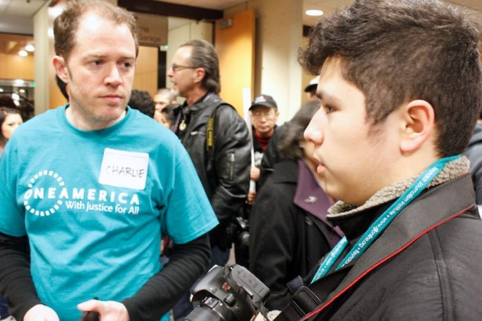 Seattle Globalist reporter Quipachtli Martinez speaks with OneAmerica Communication Director Charlie McAteer in 2013. (Globalist file photo)