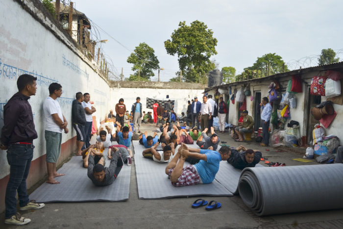 Caption: Prisoners practice yoga at Kavre District Prison. The class, taught by prisoners with yoga experience, is held each morning. (Photo by Kalpana Khanal for GPJ Nepal)