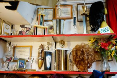 Awards for business and civil leadership, as well as hairdressing, line the walls of DeCharlene's. (Photo by Chloe Collyer)