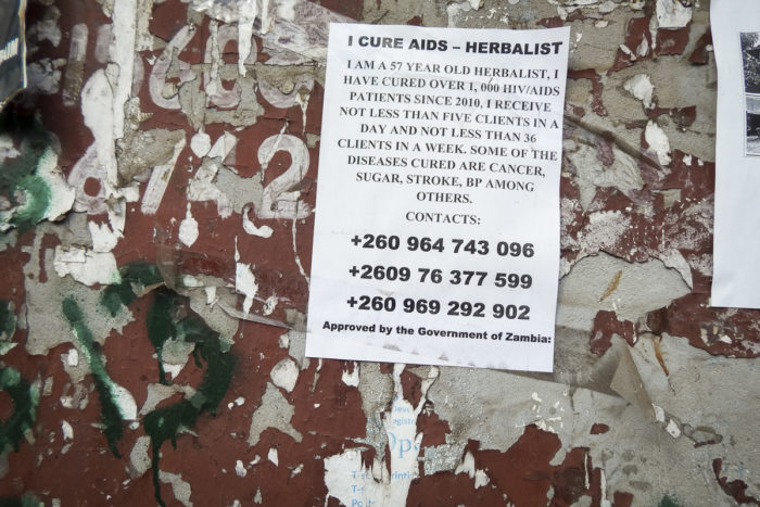 A poster in Lusaka advertises the services of an herbalist who claims to cure AIDS. Government officials say they have not approved any herbal cures for the disease, despite what the poster claims. (Photo by Prudence Phiri for GPJ Zambia)