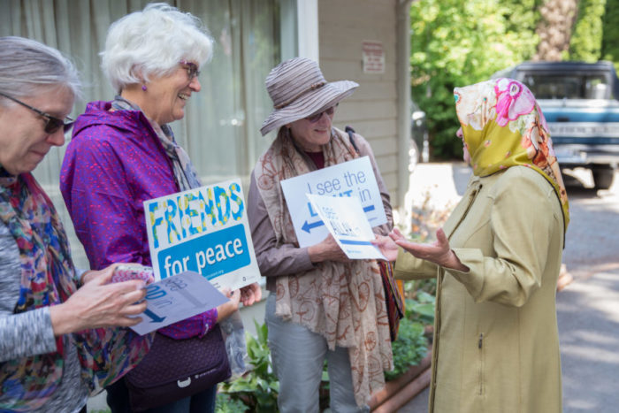 Handan Shami (on the right) thanks Seattle-area Quakers and others at the Islamic Center of Federal Way. (Photo by Alex Garland)