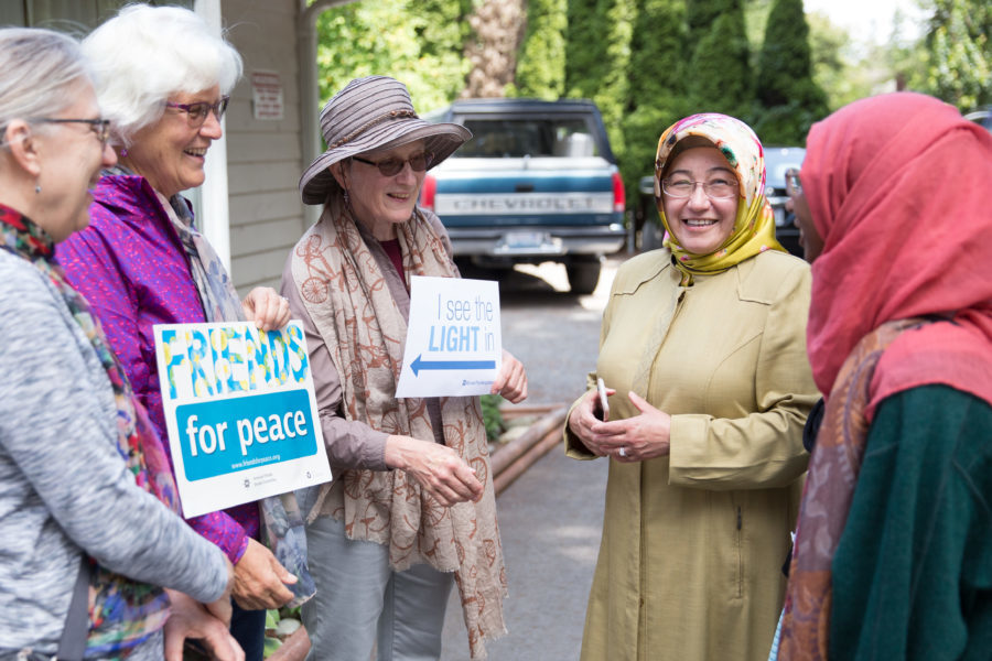 Handan Shami (second from right) thanks Seattle-area Quakers and others at the Islamic Center of Federal Way. (Photo by Alex Garland)