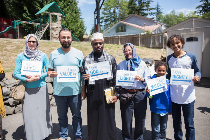 Seattle-area Quakers, pictured here with mosque attendees, formed a show of support at the Islamic Center of Federal Way, to show solidarity at the final Jummah of Ramadan. (Photo by Alex Garland.)