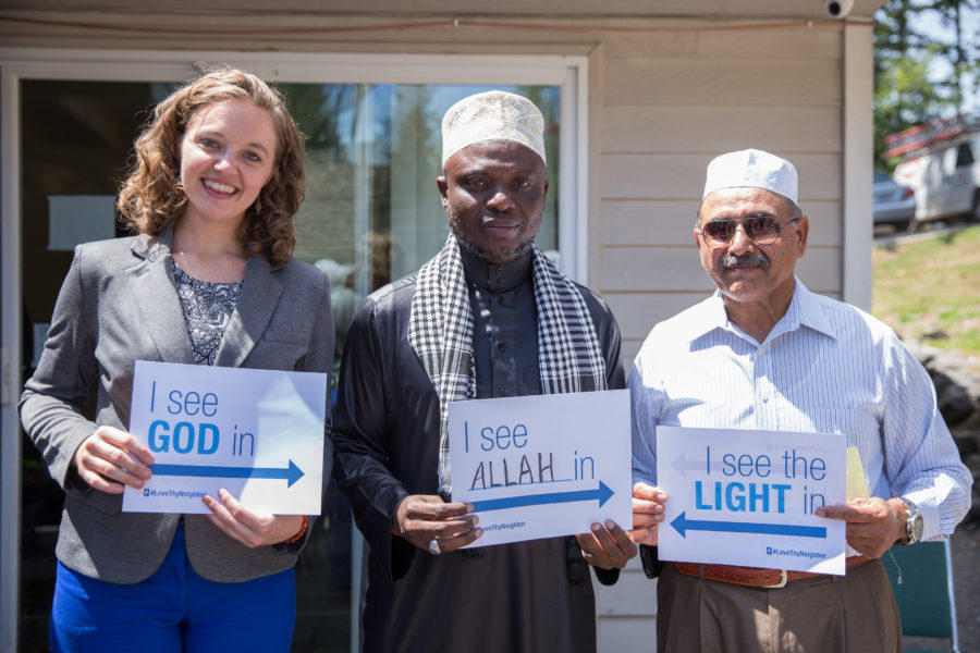 Seattle Quaker community members and peace activists visited the Islamic Center of Federal Way last Ramadan in a show of solidarity and support. Here Megan Fair of CAIR-WA stands with Imam Bazi and Shabbir Ahmed. (Photo by Alex Garland)