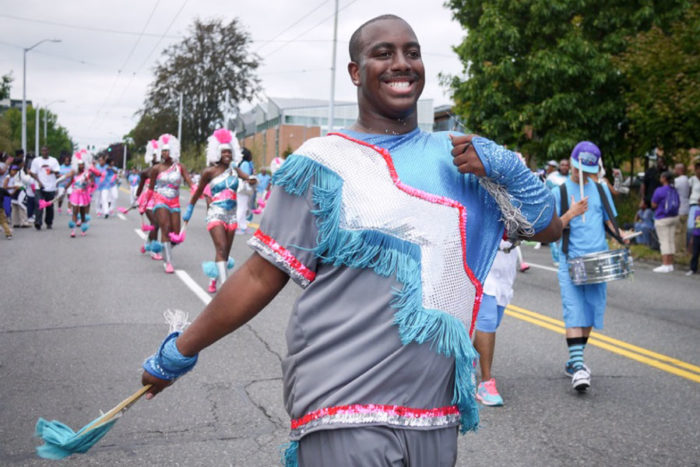 Preston McInnis marches with the Electronettes in the Umoja Festival Parade.