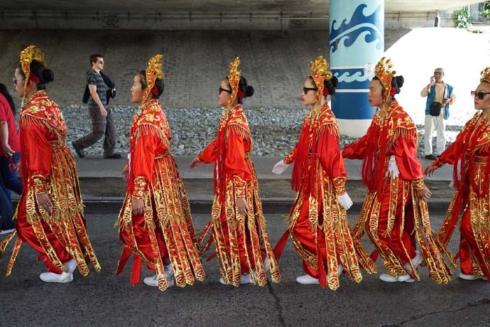 Seattle Chinese Community Girls Drill Team prepare for the Chinatown Parade.