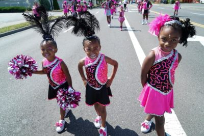 Members of the Elegance Drill Team pause in the middle of a performance. (Photo by Susan Fried)
