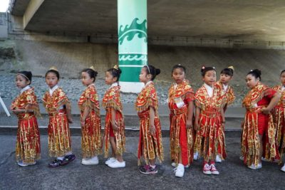 The smaller members of the Seattle Chinese Community Drill Team prepare to perform.