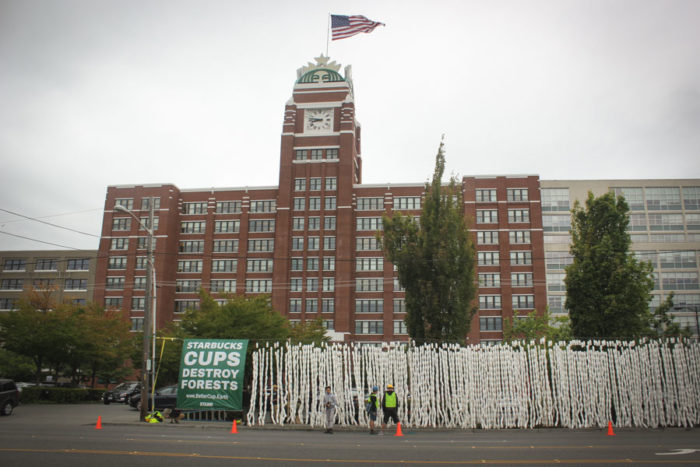 An eight foot high wall of disposable Starbucks cups lined the street in front of the company's SoDo headquarters on Wednesday morning. (Photo by Esmy Jimenez)