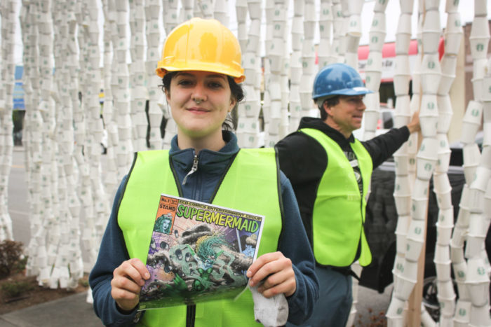 "Stand.earth Seattle coordinator Sierra Klingele holds a copy of ""Super Mermaid"" a satirical comic book distributed by Stand at Emerald City ComicCon as part of the campaign. (Photo by Esmy Jimenez)"