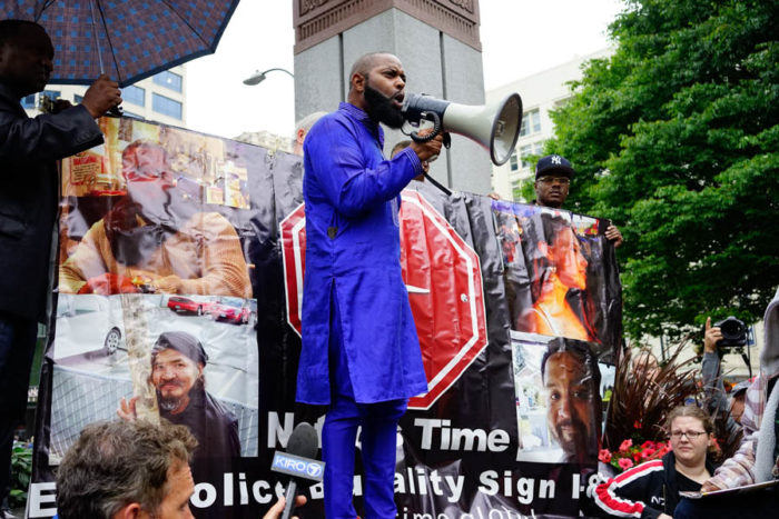 Andre Taylor, co-director of Not This Time, speaks passionately as the crowd assembles. His brother Che Taylor was killed by Seattle police earlier this year. (Photo by Chloe Collyer)