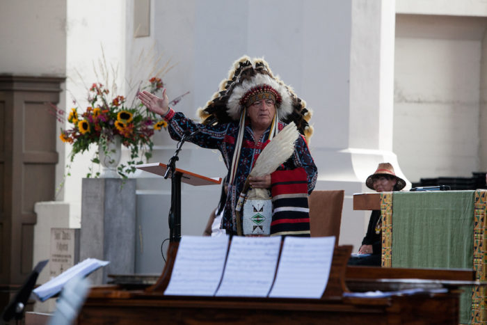 Chief Phil Lane, Jr. addresses the audience during the 2016 Lummi Nation House of Tears Totem Pole Journey celebration on August 25, 2016 at Seattleís Saint Markís Episcopal Cathedral. The Lummi Nation uses their annual totem pole journey to raise awareness of the fossil fuel industryís negative environmental effects.