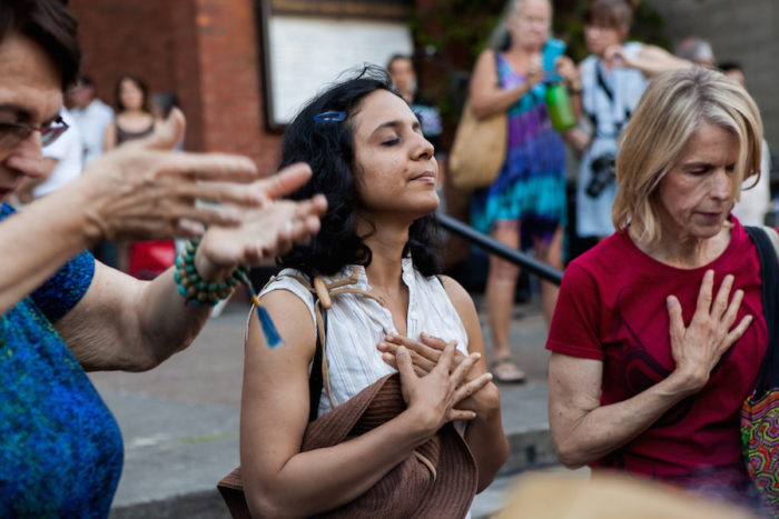 Afrin Sopariwala, of Women of Color Speak Out, participates in a smudging ceremony at the 2016 Lummi Nation House of Tears Totem Pole Journey celebration on August 25, 2016 at Seattleís Saint Markís Episcopal Cathedral.
