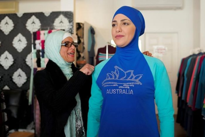 Aheda Zanetti (L), designer of the Burkini swimsuit, adjusts one of the swimsuits on model Salwa Elrashid at her fashion store in Sydney, August 23, 2016. (Photo by Jason Reed for Reuters.)