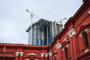 Old and new: Construction rises behind the second oldest museum in South India. Multi-story buildings, once absent in Bangalore, are springing up throughout the city. (Photo by Kate Clark)