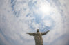 """The iconic """"Christ the Redeemer"""" statue stands over Rio de Janeiro. (Photo from Flickr by Geraint Rowland)"""