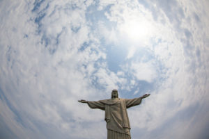 "The iconic ""Christ the Redeemer"" statue stands over Rio de Janeiro. (Photo from Flickr by Geraint Rowland)"