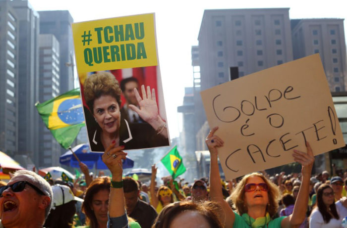 Protesters demand the ouster of suspended President Dilma Rousseff in Sao Paulo on July 31. On the same day, there were protests in Rio against her replacement, Michel Temer. (Photo from Reuters / Rodrigo Paiva)